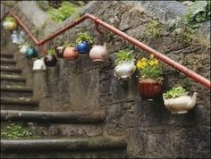 Re-purpose old teapots for planters!