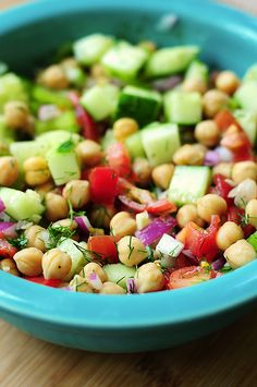 CUCUMBER & CHICKPEA SALAD. Salad  3 tbsp. olive oil; 1 (16 oz.) can Garbanzo Beans, drained; 1/2 c. tomato, chopped; 1/4 c. red onion, minced; 1 rib celery, sliced; 1 cucumber, chopped; 1 tsp. garlic, minced; 2 tbsp. fresh dill, chopped; 1 1/2 tsp. red wine vinegar; 1/2 lemon, juiced; 1/2 lime, juiced; black pepper; 1 tbsp. fresh parsley, chopped Heat 2 tbsp. of oil in a sauté pan over med. heat. Stir in beans, cover, turn off heat. Set aside. Gently toss all. Top with parsley.