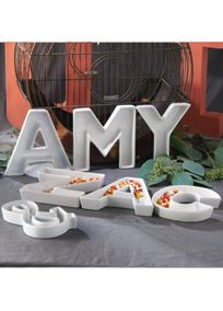 """How do you show your appreciation to your wedding guests? Spell it out to them with these uniquely modern monogram dishes. Perfect for giving as favors and gifts, or for using as wedding centerpieces and decor. Features and Facts:  Sold individually.  Ceramic.  White 0.75"""" deep, 6""""H.  Available in letters A-Z, ampersand (&) and heart shape."""