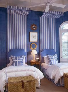 blue and white guest room with twin beds