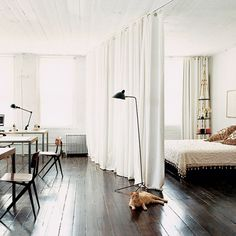 loft living has always been in my heart. this is a great example of how to separate living spaces. simple and clean.
