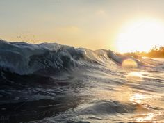 Waves in the Setting Sun by Catchline Studios on Creative Market