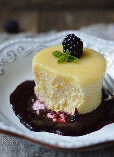 Meyer lemon pudding cakes with blackberry sauce.
