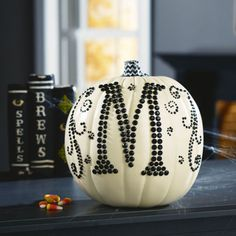 DIY monogram initial craft pumpkin using bling stickers. Perfect for fall decor and Halloween