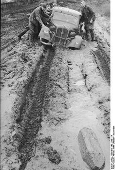 German soldiers pushing car out of the mud, Russia, October 1941