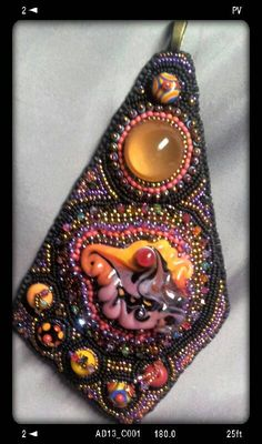 Check out this item in my Etsy shop https://www.etsy.com/listing/193686192/tangent-tie-carnival-carousel-bead