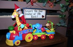 I heard my ipod playing in the child care and I thought that was really weird because everything was shut down..... I went into the play room and wild one was playing.... That's when I noticed Cuddles riding the giraffe... Boy that elf sure is a wild one.... :)