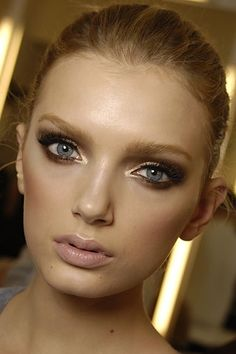 Great summer-night-out look: First line eyes with black or brown eyeliner. Then line the corner and upper eyelid with gold eyeliner & finish with mascara for a bright yet sultry look. (also brightens the eyes & brings them out!)