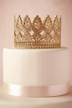 Crowned Cake Topper from BHLDN   make the bride-to-be feel like a princess for the day