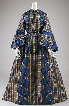 Fiber not known, American or European, 1862. Front cut in one piece, 2-piece back, full skirt. Features, collar, flared sleeves, tasseled waist cord, button frogs. Decorated with silk ribbon an gimp. MET- gorgeous wrapper! wrap-it-up