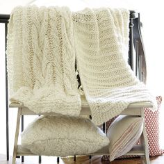 If you've ever had a favorite cable knit or Irish Fisherman's sweater, you'll know exactly how cozy our Wiltern Knit Throw feels. The chunky weave is hand knitted in thick cream wool.