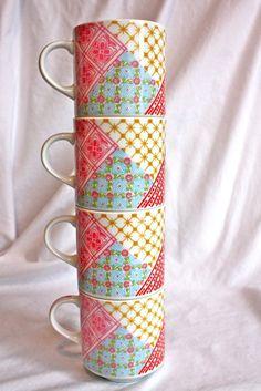 set of four matching, patterned coffee mugs