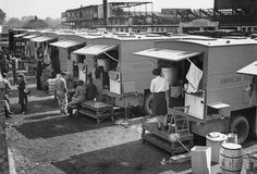 "Great Britain -- American Red Cross lines up its Clubmobiles in preparation for the ""second front ~"