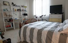 White & Grey Bedroom with Ladder Shelves