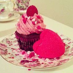 Yummy treat for Valentine's Day! Chocolate cupcakes with raspberry buttercream