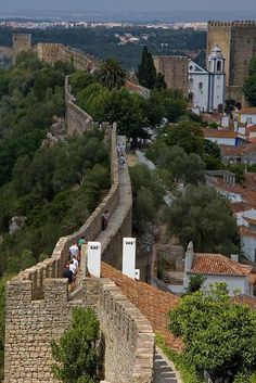 A walk on the walls of fortified village of Obidos, heading to visit the Medieval #Casle #Portugal   Source: Flickr / roveclimb -