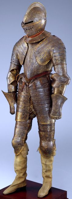 Armor for heavy cavalry, ca. 1600, one of the best-preserved French armors dating from the reign of Henry IV (1589–1610), this example demonstrates the French preference for completely gilt armors, it retains its original yellow silk helmet lining and red leather straps sewn with metallic thread. In spite of its rich decoration, this armor was intended for use in battle. 77 lb. 2 oz. (34.98 kg), Height, 57 in. (144.78 cm), Met Museum.