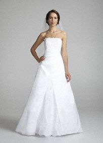 Look like a true princess on your special day in this stunning strapless A-line gown!  Elegant beaded corded lace applique detail adorns the bodice and skirt.  Skirt features split back to shape a slimming A-line silhouette.  Lace-up back adds allure.  Fully lined. Back zip. Imported polyester. Dry clean only.  Available online in White.