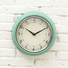 for the kitchen | Add a little retro vibe to a home office or kitchen with this mid-century inspired metal wall clock.
