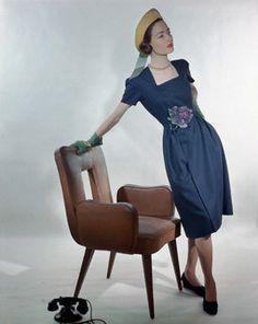 Model is wearing a navy spun rayon, wrap front dress by Hattie Carnegie, 1946 - so pretty! #spring #vintage #fashion #1940s