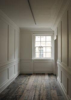 Floors and paneled walls.