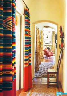 mexican inspired drapes. great hallway!