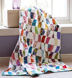 Piecing this beautiful quilt requires a bit of precision and patience, but the end result is well worth the effort-ribbons of colored curves cascade down the quilt like a rainbow waterfall. This quilt, Curvy by Mark Lipinski, is fat quarter friendly.