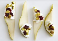 A pear paired with pistachios, dried cranberries and cheese. / Real Simple