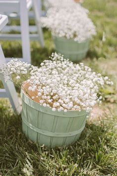 baby's breath in baskets lining the ceremony aisle, photo by Hot Metal Studio http://ruffledblog.com/white-barn-wedding #weddingideas