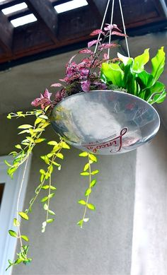 ~ vintage hubcap = planter   (scroll down for more ideas)