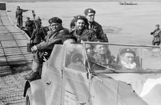 Airborne troops cross back over the Rhine in a captured German Kubelwagen car, March 1945., Hardy, Bert