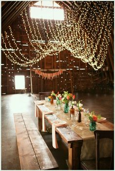 table settings, hanging lights, wedding receptions, barn reception, picnic tables, barn weddings, barn parties, string lights, rustic weddings
