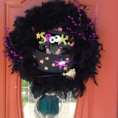 Halloween wreath! Wrap boa around grapevine wreath. Wire a sign (mine is from hobby lobby) to the wreath. Tuck in some garland, and done!
