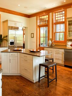 Oak trim with white cabinets in the kitchen