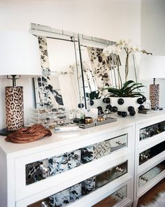 \\\ A white dresser topped with mirrors and leopard-print lamps \\\
