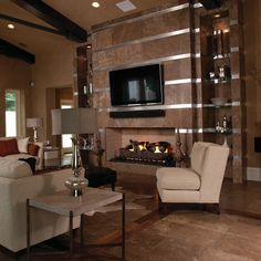 Details: The New American Home 2011. Photo features Café Au Lait Travertine honed on the floor and fireplace wall.