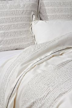 Bedding patchworked with text from Aesop's fables (Anthropologie)