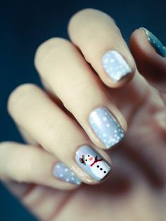 Cute snowy nails with frosty the snowman on the ring nail. | Christmas Nail Art