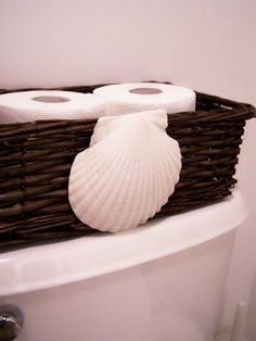 shell basket accent--cute idea for storing toilet tissue