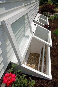 Window well cover idea: Redi-Exit Egress Systems' Two Deluxe Custom Wells With Custom Hinged Covers