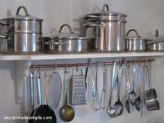 Recycled copper piping + shelf = great pot/utensil rack.