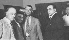 Al Capone and His Family   Al Capone, far right, stands next to his attorneys in a Chicago ...