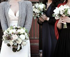 winter bouquet with dusty miller, brunia silver spray, white ranunculus, pinecones, etc