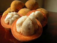 Santol also known as katon or wild mangosteen or sandorica. The fruits are round with some wrinkles extending distance from the base. The milky fluffy rind contains a milky juice. The edible juicy pulp is sweet or sour and surrounds 3-5 brown seeds which are inedible.
