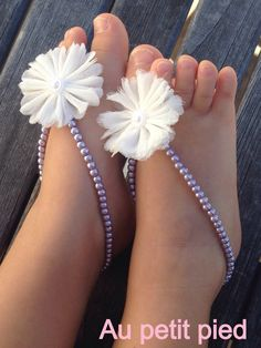 White flower and purple beaded baby barefoot sandals on Etsy, $22.00