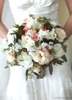 Peach lisianthus, white garden roses, peach spray roses, and seeded eucalyptus.