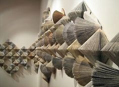 Wendy Kawabata        Withdrawn from Circulation - 2009        books all folded in the same way to create an impressive installation