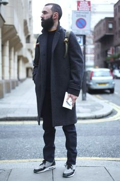 Charcoal Grey Wool Overcoat, Black Jeans and Sweater, and Cool Nike Sneakers. Men's Fall Winter Fashion.