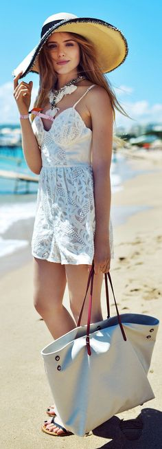 Gorgeous white lace strappy romper and silver hand bag and huge hat and shoes the best way to show fashion