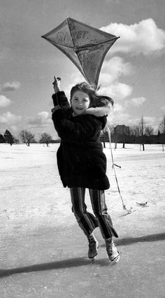 Anne Sullivan makes the best of two seasons in March 1977. She used a windy day to launch a kite while on ice skates at Memorial Park in Omaha. THE WORLD-HERALD